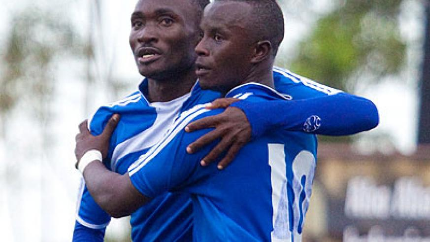 The two goal scorers, Cederic Amissi (L) and Robert Ndatimana, celebrate together on Sunday. (Timothy Kisambira)