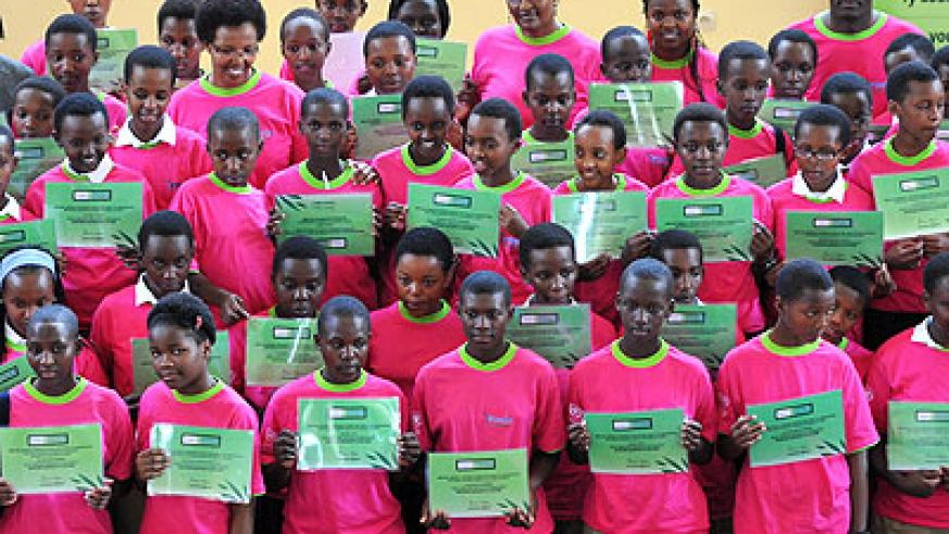 Some of the school girls who were awarded for good performance at an event held in Kigali last weekend. (Courtesy)