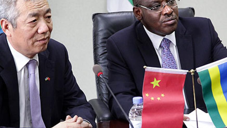 Minister Claver Gatete with Chinese Ambassador to Rwanda, Shen Yongxiang after signing the agreement yesterday. (John Mbanda)
