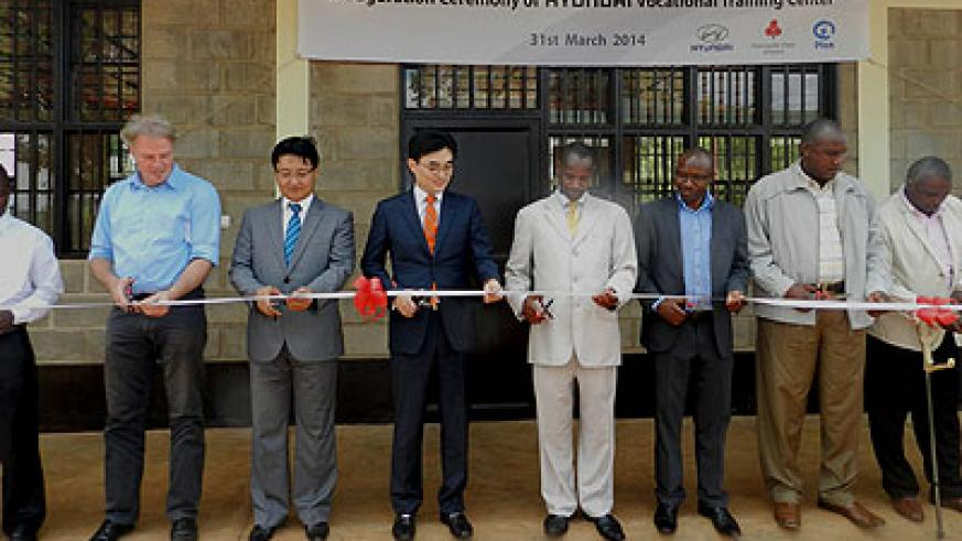 Hyundai Motor and Plan International officials were joined by locals at the TVET facility launch in Rubona on Monday. (Stephen Rwembeho)
