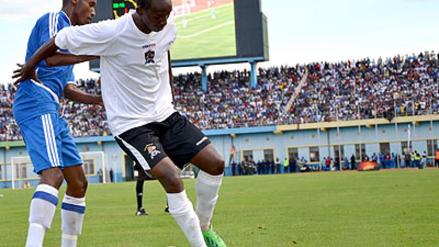 Jean-Claude Iranzi, right, tries to shield the ball from Rayon Sports midfielder Djamal Mwiseneza during a league match. The two bust to to local scene in 2004. (File)