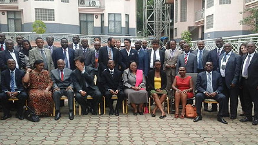 Members of the EABC in a group photo. They called for removal of bottlenecks to trade. (Peterson Tumwebaze)