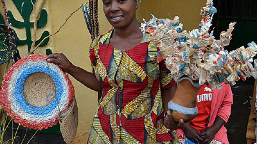 Ujeneza holds some of the products she makes. (Jean d'Amour Mbonyinshuti)