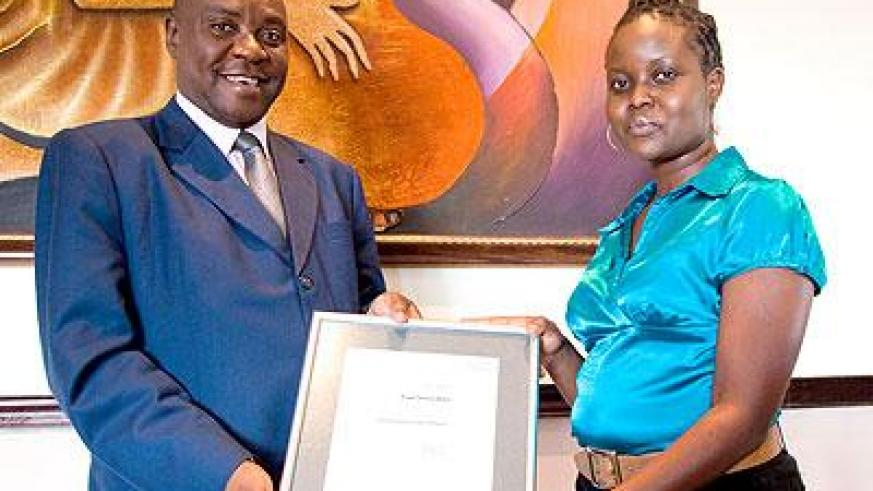 Muia, the General Manager of Serena (L) Hotels in Rwanda poses in a photo with Alicia Akoth of SGs Kenya Limited . (Timothy Kisambira)