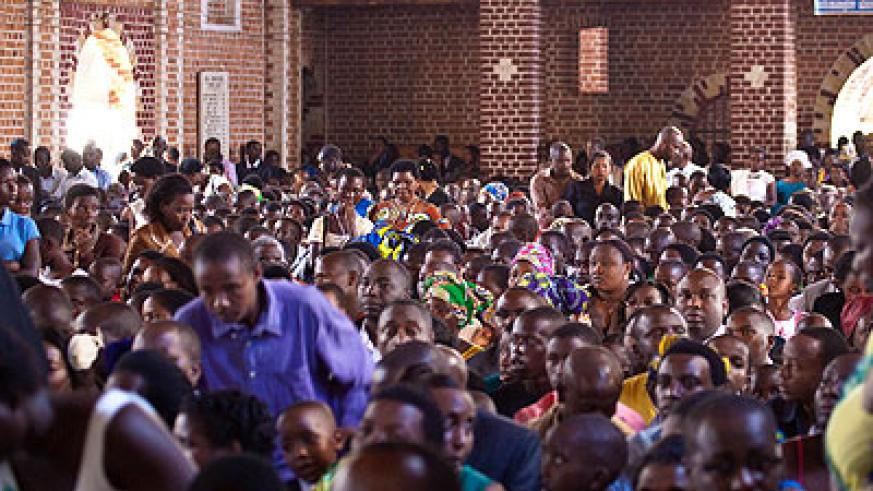 Christians attend mass at Ste Famille Church in Kigali in December. Because  very many people were killed in church, the level of trust in Christianity has gone down. (File)