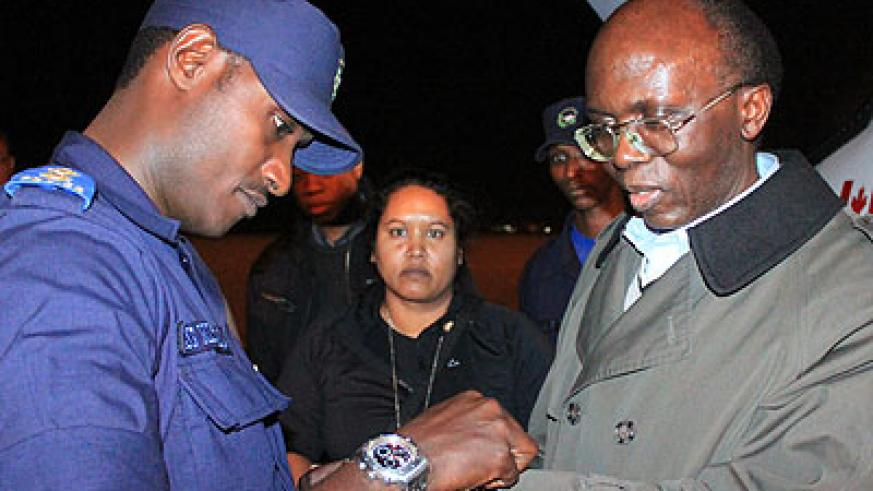 A Rwandan security officer receives Leon Mugesera, a Genocide suspect, upon his extradition from Canada in 2012. (File)