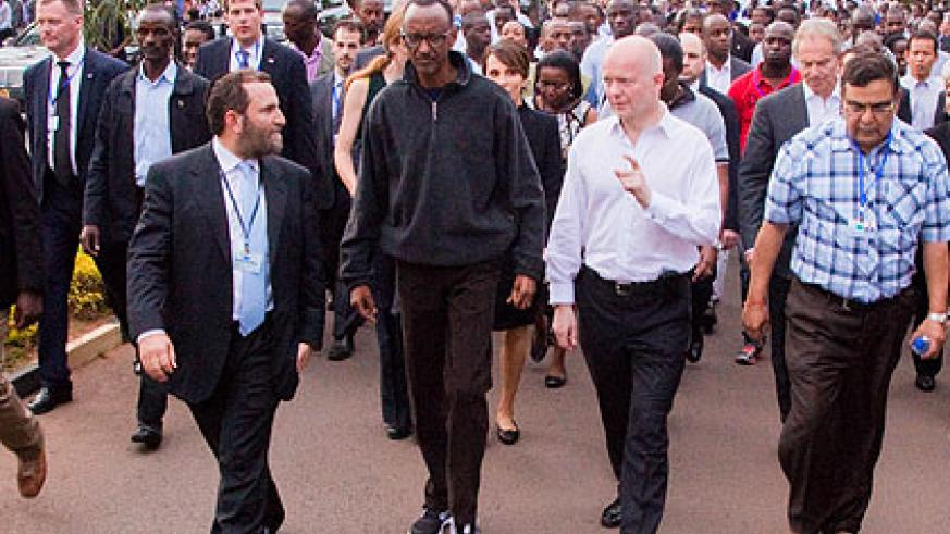 President Kagame chats with dignitaries during the Walk to Remember. (Timothy Kisambira)