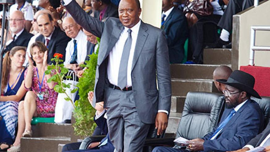 Kenyatta acknowledges his introduction to the crowd on Monday. (Timothy Kisambira)