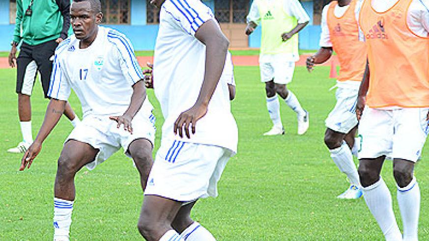 Amavubi Stars coach Eric Nshimiyimana, far left, oversees his players during a training session. File
