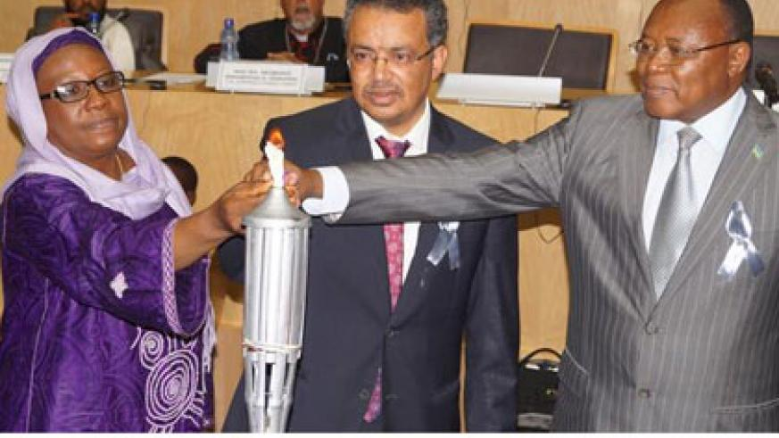 Dr Ghebreyesus (C), Dr Aisha Abdullahi, the AU Commissioner for Political Affairs (L), and Prof. Joseph Nsengimana, the Ambassador of Rwanda to Ethiopia, lit the Flame of Remembran....