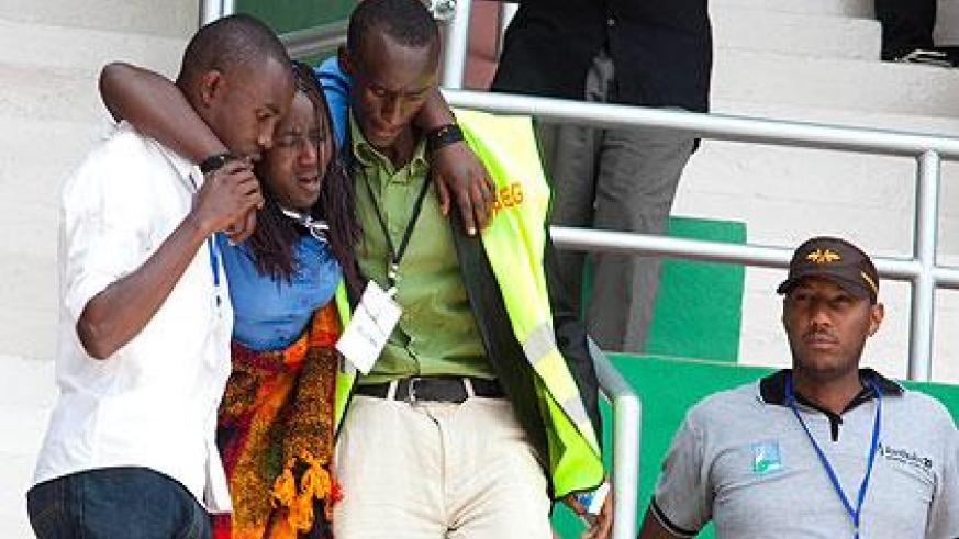 Emergency workers attend to a trauma victim during the 20th commemoration at Amahoro Stadium. (Timothy Kisambira)