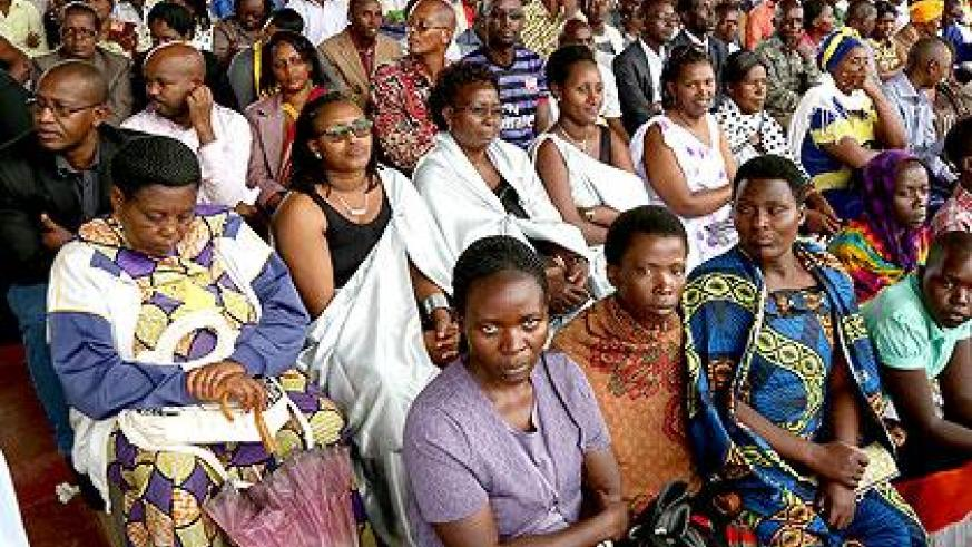 Residents listen to speeches during the ceremony to receive Kwibuka Flame at IPRC - Kigali, former ETO Kicukiro. (Courtesy)