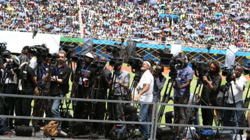 Journalists cover the 20th commemoration event at Amahoro Stadium last week. Timothy Kisambira.