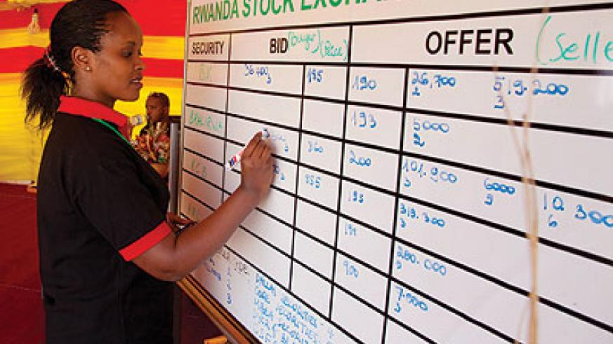 A dealer computes the day's trade at the local bourse. EAC stock markets are pushing for similar laws to ease movemnet of capital across the region.