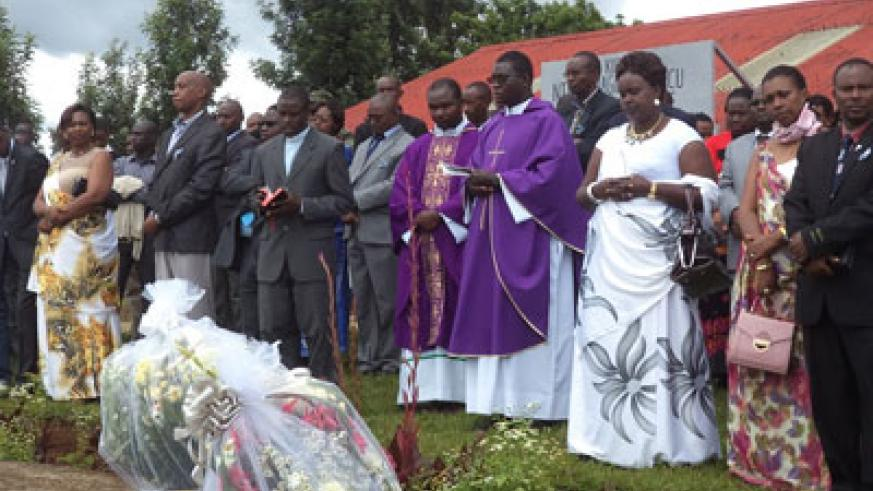 Residents and relatives pay tribute to victims of the Genocide. JP Bucyensenge.