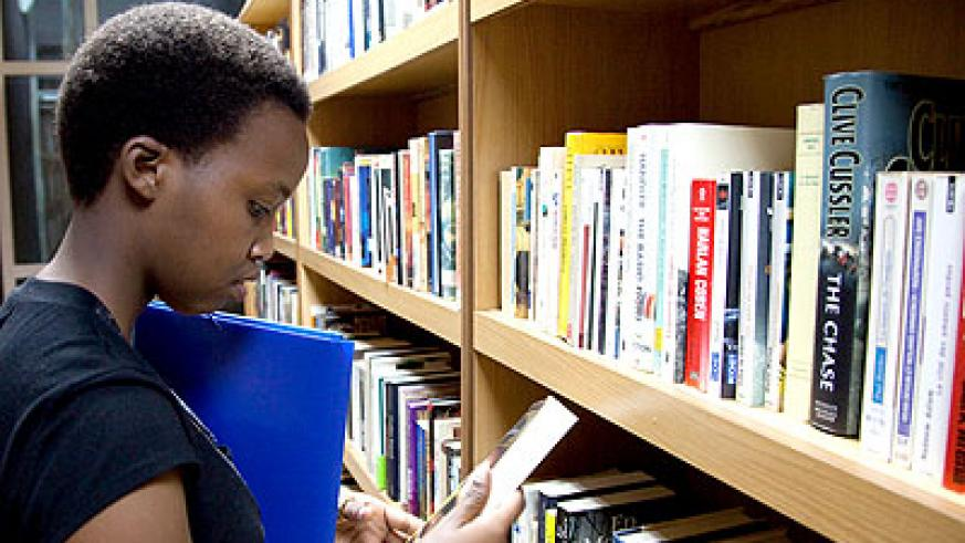 A student reading a book in the Kigali Public Library. (Timothy Kisambira)