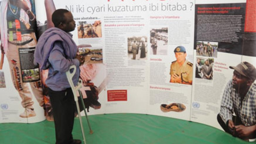 A man looks at pictures at Kigali Genocide Memorial Centre. File.