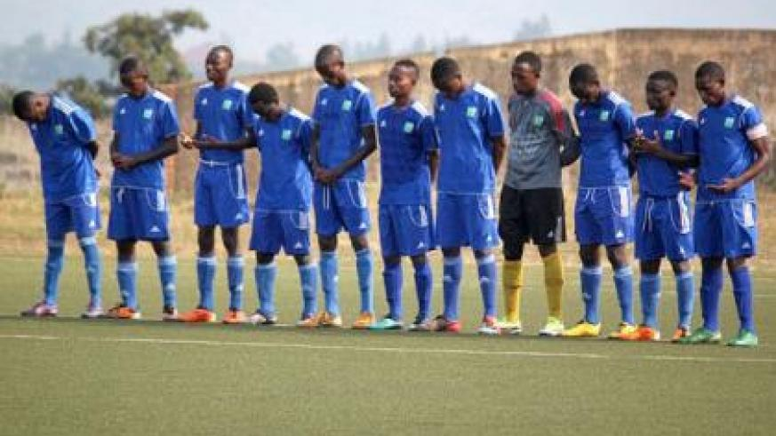 Esperance players pray before  kick off of their first round league game against Mukura, which the latter won 1-0. File