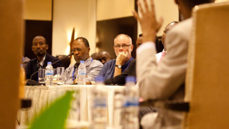 Delegates at the summit listen to The New Times' Kennedy Ndahiro, a panelist at the forum, make a point. T. Kisambira.