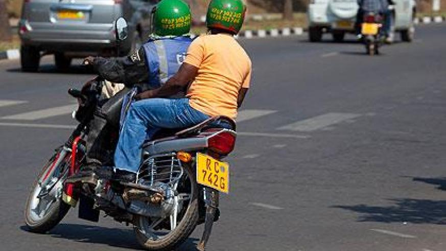 A motorcyclist carries a passenger. Motorcycle taxi operators caught breaking the rules will be penalised. (File)