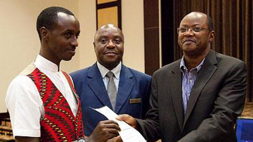 Silver Furaha (L) receives a certificate from Bart Gasana, the chairperson of tourism chamber at the Private Sector as Charles Muya looks on. (Timothy Kisambira)