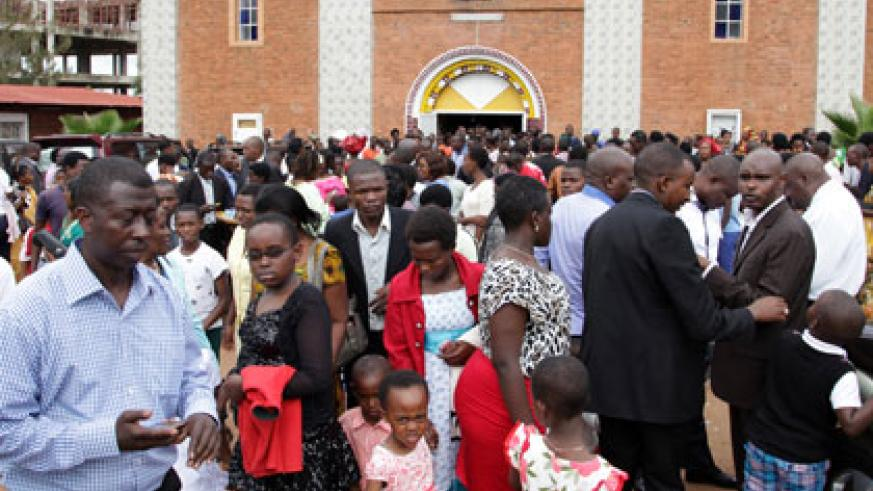 Christians leave St Famille in Kigali after Easter Prayers yesterday. Religious in Kigali preached unity and reconciliation among Rwandans.  John Mbanda.