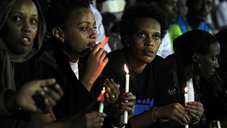 Rwandans kept a candle light vigil at Amahoro Stadium during the 20th anniversary commemoration of the 1994 Genocide against the Tutsi, on April 7. Courtesy.