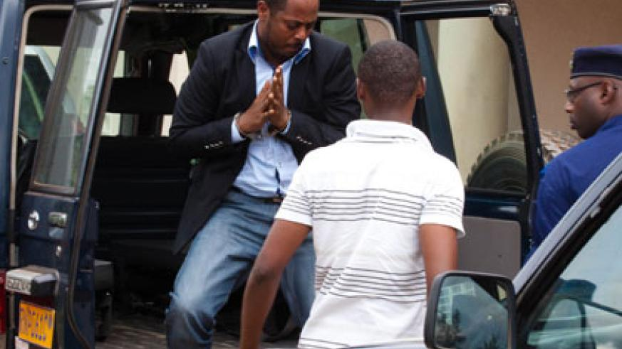 Mihigo gets out of the Police car on his arrival at Kacyiru Primary Court yesterday.Timothy Kisambira.