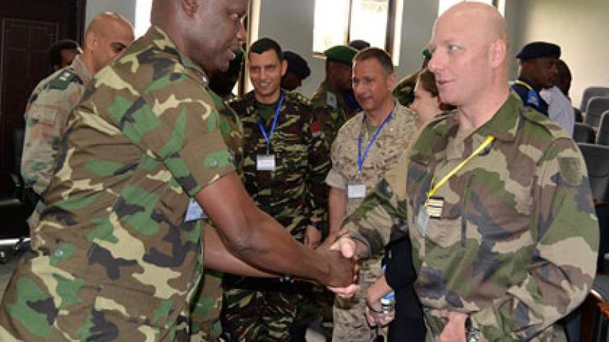 Brig. Gen. Charles Karamba welcomes Lt. Col. Richard Zabot, who heads the visiting team of facilitators. Jean d'Amour Mbonyinshuti.