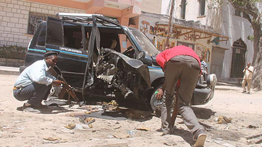 The wreckage of a vehicle that exploded in Mogadishu, killing Isak Mohamed Ali, a Somali lawmaker. Unknown gunmen shot dead a Somali lawmaker on Tuesday, making the deceased the se....