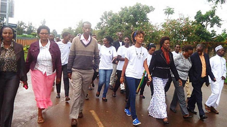 Mourners walk in rememberance of the youth in Rwamagana who perished in the Genocide against the Tutsi .Stephen Rwembeho.