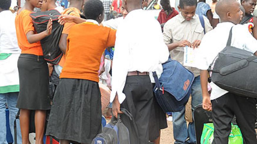 Parents are encouraged to buy school requirements early and accompany their children to school for the new term. (Timothy Kisambira)