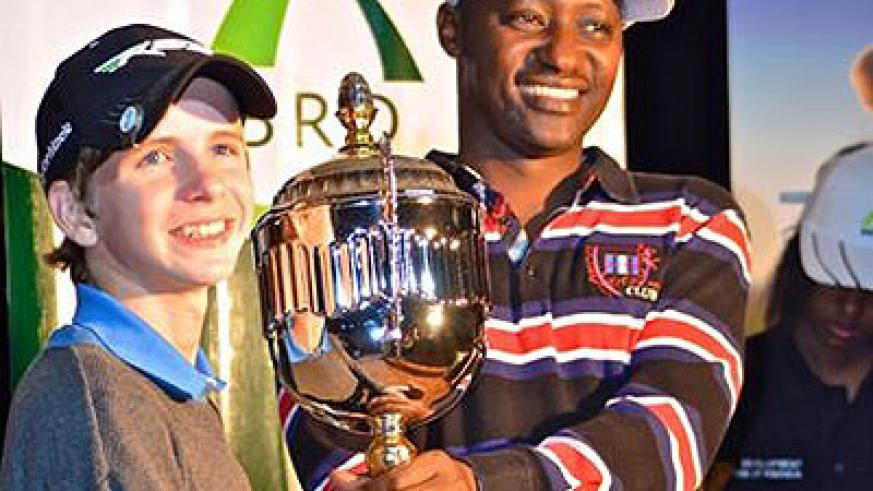 Aaron Taylor Koonce (L) won the Rwanda Open title for youth players recently in Kigali. (Courtesy)