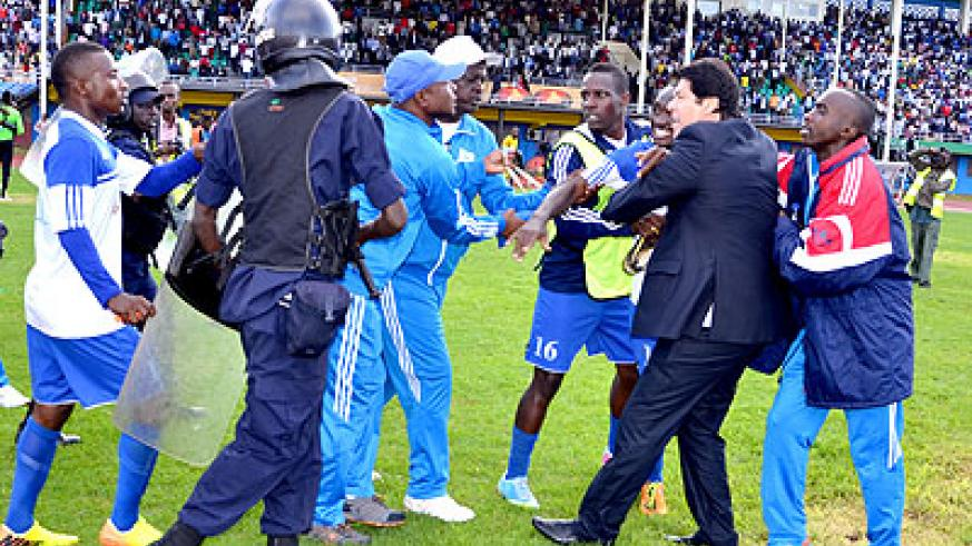 AT THE FORE; Rayon Sports head coach Luc Eymael, and striker Cedric Amissi, 3rd from right, have been banned for setting off the violence last week. File