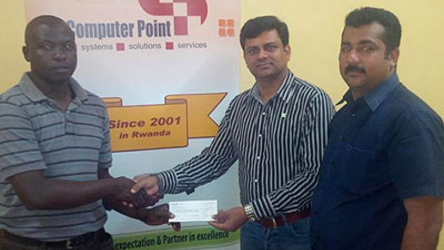 RCA General Manager Joshua Mwanja, left, receives the cheque from Computer Point General Manager Dinesh Vachakkara, right. Courtesy