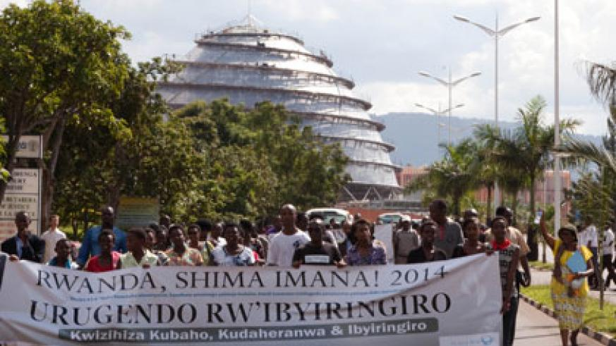 Members of the Pentecostal Church walk for hope and peace in Kigali yesterday. Timothy Kisambira.