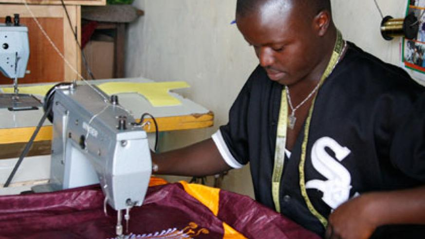 A tailor at work. The meeting, ahead of Labour Day, will address challenges in the labour market. Timothy Kisambira.