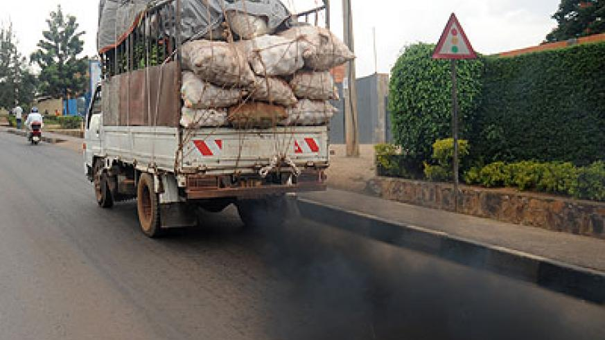 A cargo truck emits half-combusted exhaust gas. Timothy Kisambira.