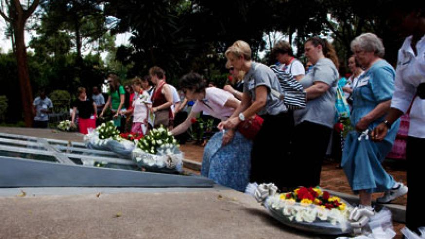 Some of the visiting Americans pay respects to Genocide victims at Kigali Memorial Centre yesterday. Timothy Kisambira.