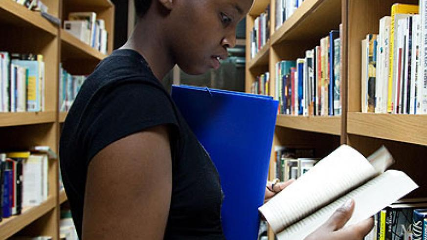 A young lady reads a book at Kigali Public Library. File.
