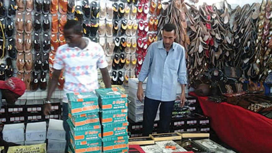 An exhibitor sets up his stall yesterday. The expo has attracted 60 firms. The New Times / Peterson Tumwebaze.