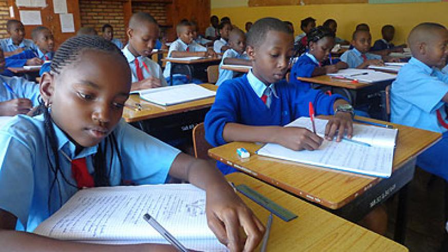 Pupils writing notes in class. It is important to finish the syllabus early to allow time for revision and exams  /Jean de la Croix Tabaro