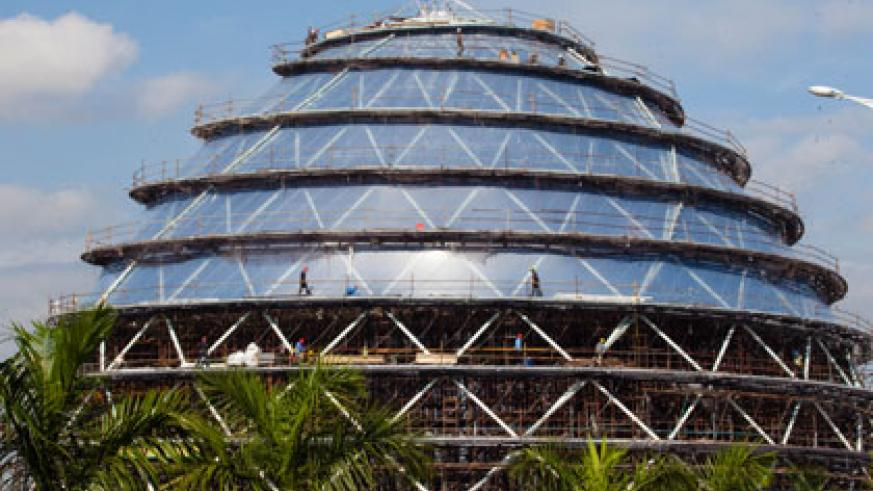 Construction workers busy at the Kigali International Convention Centre in Gasabo District. Timothy Kisambira.