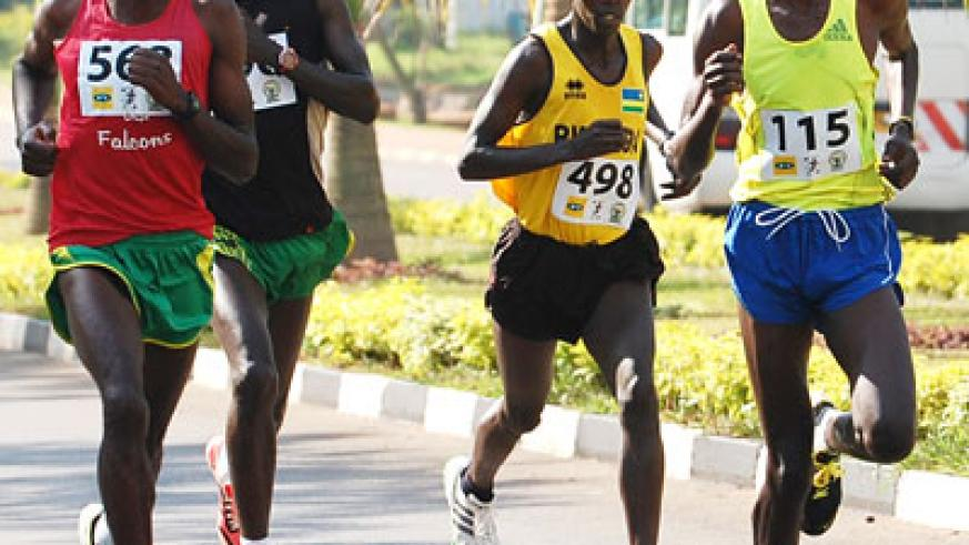 Alex Nizeyimana, 2nd from left, and Godfrey Rutayisire, right, will be among the home favourites in the half and full marathons respectively. File.