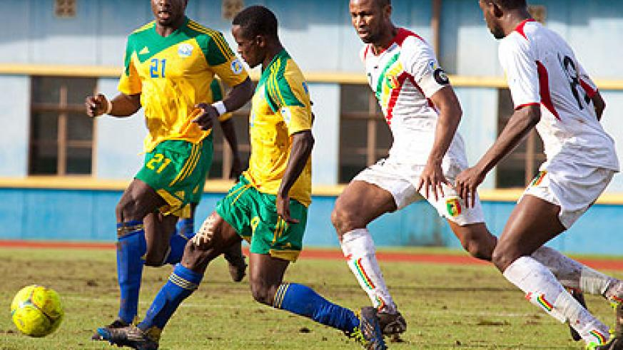 Amavubi Stars captain Haruna Niyonzima, seen here in action against Mali during a 2014 Fifa World Cup qualifier, will lead the team against Botswana on May 10. File.