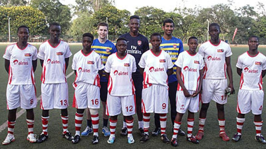 Airtel Rwanda team and the two tutelage coaches from Arsenal Academy, Rupen Shah and Nathan Asare, standing behind. Courtesy.