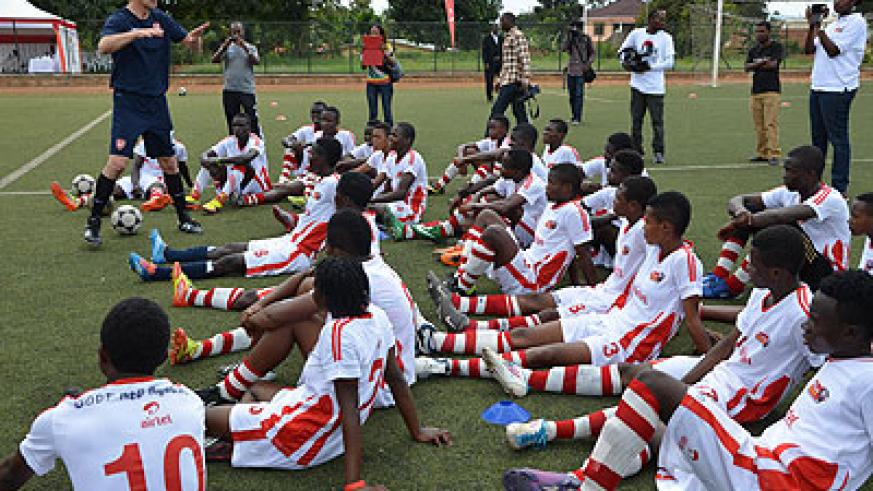 Arsenal Legend Tony Adams tips African youngsters who have been attending the Airtel-Arsenal soccer clinic in Rwanda. He is launching Coach the Coaches course today. S. Ngendahimana.
