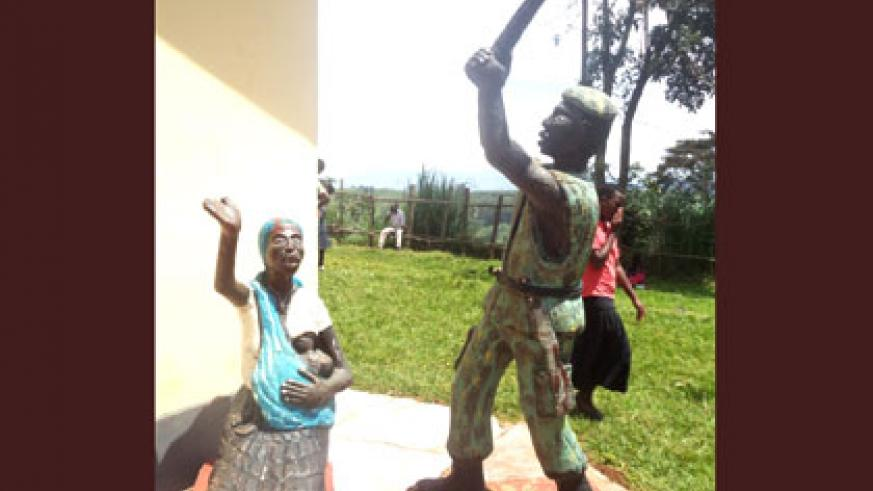 A statue erected near the entrance of the Mibilizi memorial site depicting a militia killing a woman, while below right, the Mibilizi church whose backyard was defaced with human b....