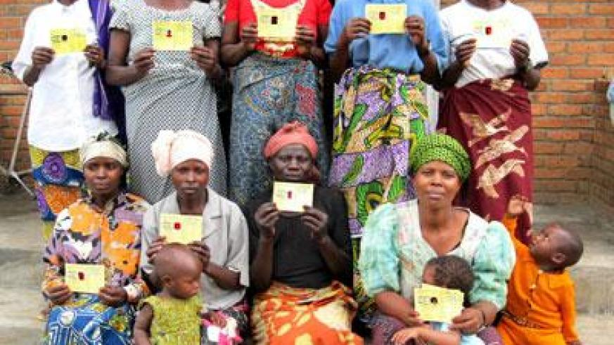 Women display their health insurance cards. (File)