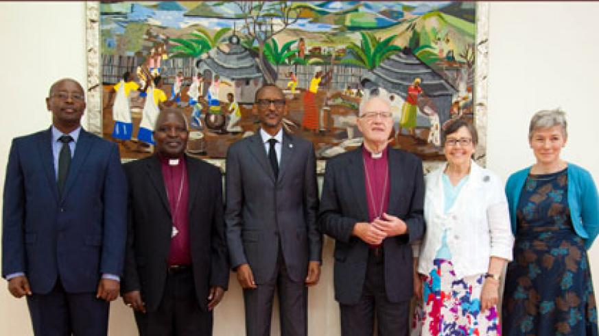 President Kagame  (C) poses in a group photo with retired Archbishop of Canterbury George Carey (3rd right), the bishop's wife Lady Illeen Carey, Henrietta Blyth, Rwanda's Angl....